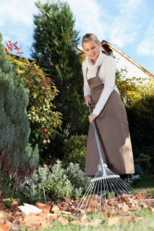 compost: woman gardening with rake
