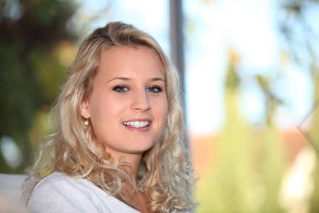 all smiles: portrait of cute blonde all smiles Stock Photo
