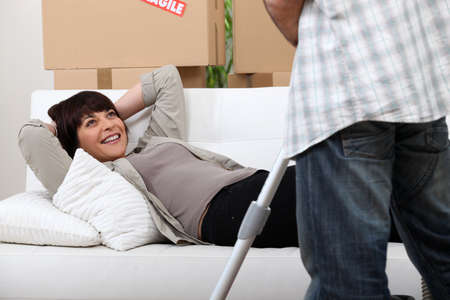 Woman resting on couch photo