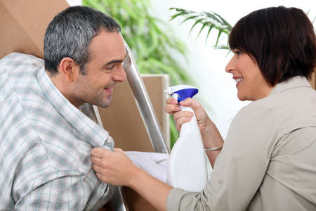 Couple installing furniture Stock Photo - 14028063