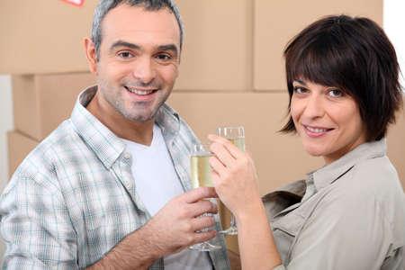 Couple celebrating on moving day Stock Photo - 14028744