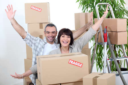 Excited couple on moving day photo
