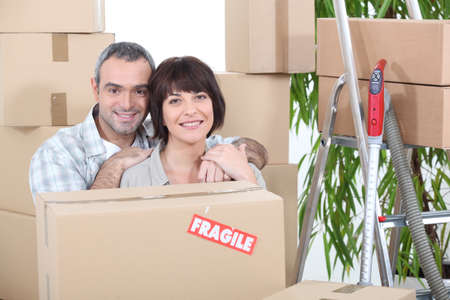 Couple stood by packed boxes Stock Photo - 14011920