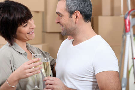 Couple toasting during moving photo