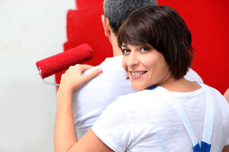Couple painting in red photo