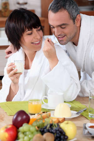 greying: couple having breakfast Stock Photo