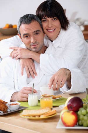 Couple at breakfast in bathrobes Stock Photo - 14019681