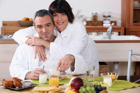 married couple having breakfast photo