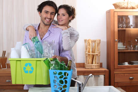 environmentally friendly: Couple sorting the recycling
