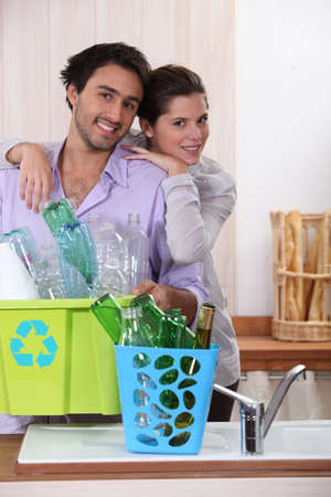 couple recycling products photo