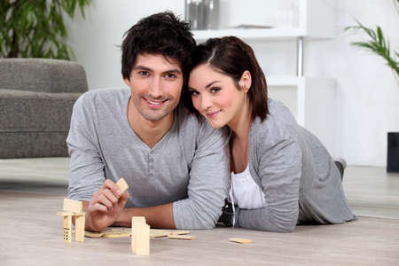 dominoes: Couple playing dominoes