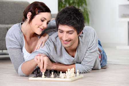 happy couple playing chess photo