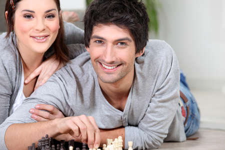 Couple playing chess photo