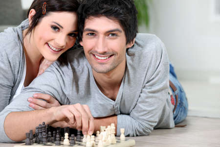 opponents: Attractive couple playing chess