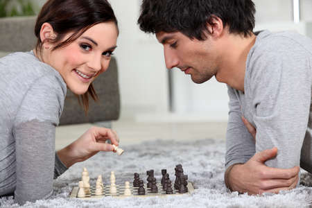 Couple playing chess Stock Photo - 14028173