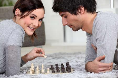 Couple playing chess Stock Photo - 14028173