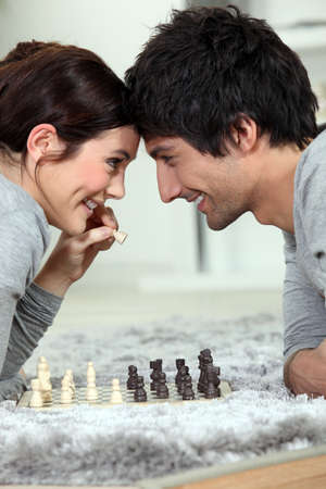 love strategy: Couple playing chess