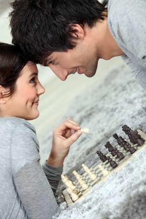 Couple playing chess photo