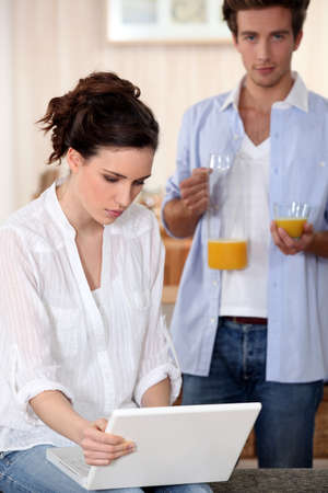 Couple drinking fruit juice in the morning photo