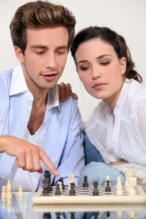 young couple playing chess Stock Photo - 14015248