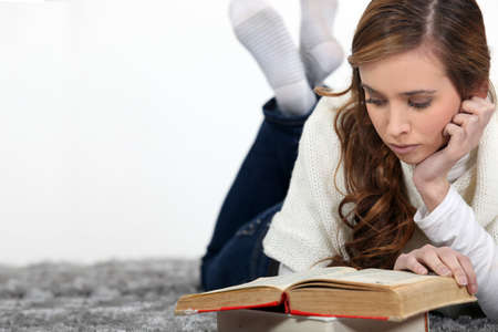 relaxed girl reading a book Stock Photo - 14004120