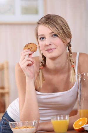 Woman eating a well balanced breakfast photo
