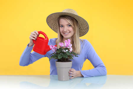 Woman watering a pot plant