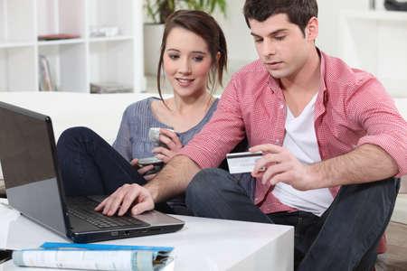 cryptogram: Couple shopping on the internet Stock Photo