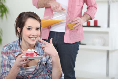 Woman eating a piece of cake Stock Photo - 13976849