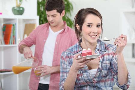 guilty pleasures: Euphoric woman eating cake Stock Photo