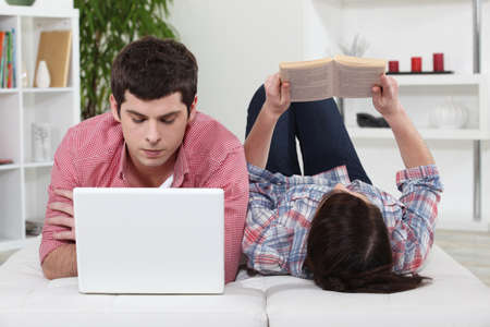 Boy and girl looking at computer photo