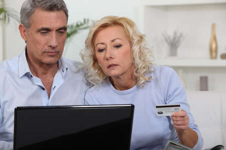 Middle aged couple shopping online. Stock Photo - 13977368