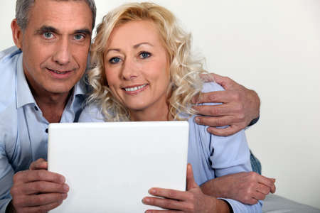 Middle-aged couple with computer Stock Photo - 13977034