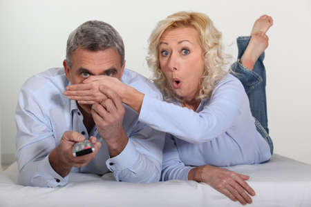 Woman trying to block her husband's view Stock Photo - 13976810