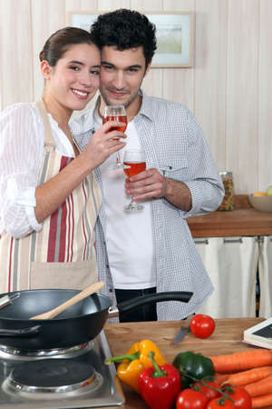 everyday people: Couple in kitchen with glass of wine