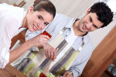 Man preparing a meal for his girlfriend photo
