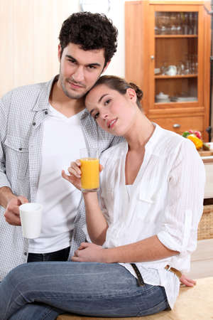 Couple in kitchen with coffee and orange juice Stock Photo - 13977725