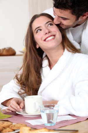 bathrobes: Romantic couple having breakfast together