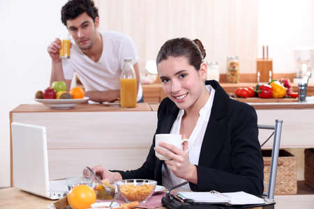 Young couple having breakfast together in kitchen photo
