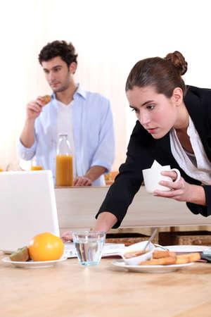 Woman rushing through breakfast photo