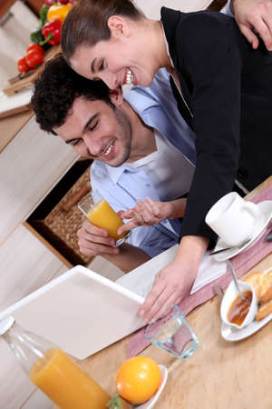 happy young couple at breakfast photo