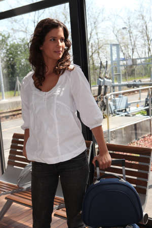 Woman in train station photo