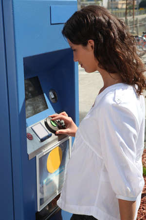 woman using ticket machine photo