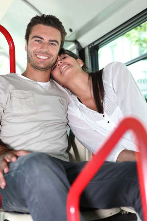 Couple on public transport photo
