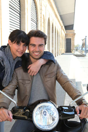 Woman hugging a man on a motorcycle photo