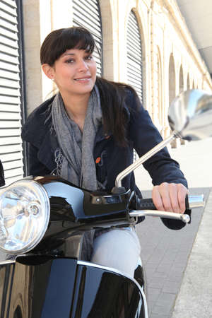 Woman on her motorcycle in the city photo