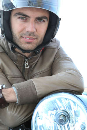 Young man on a motorbike photo