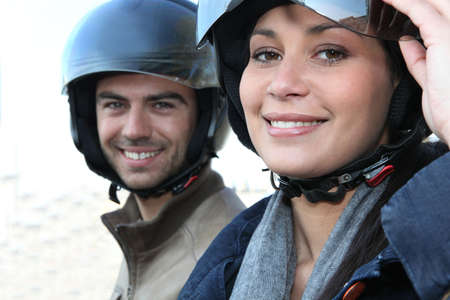 Couple with motorbike helmet photo