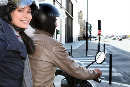 Trendy couple on a moped photo