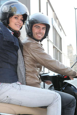 couple of bikers with helmets photo